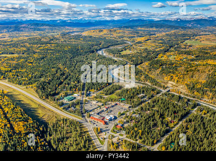 Aerial  view of the hamlet of Bragg Creek, Alberta with Elbow River and Rocky Mountains in background. - Stock Photo