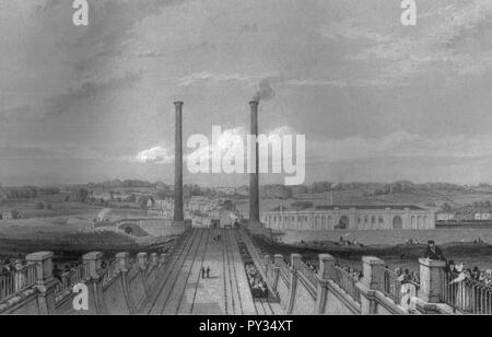 Camden town engine works and stationary steam engine chimneys. - Stock Photo