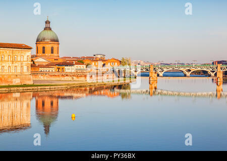 The Saint Pierre Bridge and the dome of the La Grace Hospital reflecting in the Garonne, Toulouse, - Stock Photo