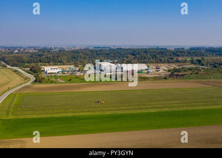 Aerial view on Waste and Recycling Centre in rural landscape, household waste displosal and treatment, ecology and earth preservation - Stock Photo