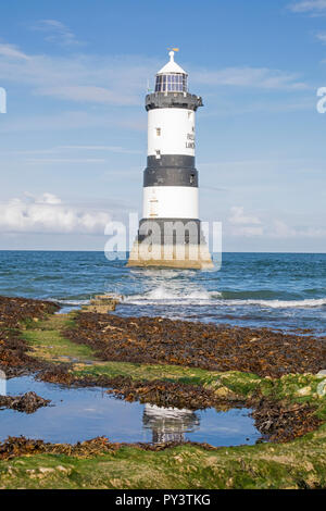 Trwyn Du Lighthouse at Penmon Point on the Isle of Anglesey - Stock Photo