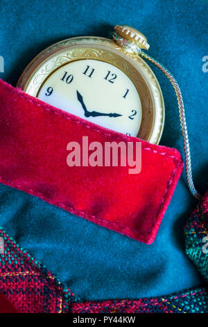 close up detail of Grandad's pocket watch and chain from Grandpa Bear teddy bear soft cuddly toy by DanDee - Stock Photo