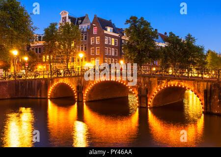 Amsterdam Illuminated canal bridge over Keizergracht canal and Leliegracht bridge Amsterdam Holland The Netherlands EU Europe - Stock Photo