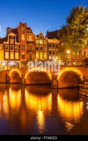 Amsterdam Illuminated canal bridge over the Singel Torensluis Canal Amsterdam canal amsterdam bridge Holland The Netherlands EU Europe - Stock Photo