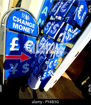 Money changing kiosk on Whitehall, London, England, UK. Currency postcards on sale - Stock Photo