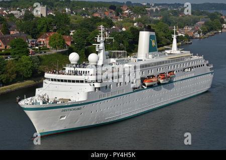 Cruiseship Deutschland passing the Kiel canal - Stock Photo