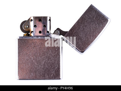 Old scratched gasoline cigarette lighter isolated on white background. - Stock Photo