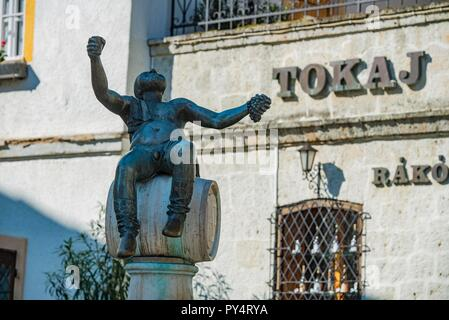 Statue of a happy man in the center of the town  Tokaj enjoying the famous Tokaj-wine of the region, which was declared UNESCO World Heritage in 2002 - Stock Photo