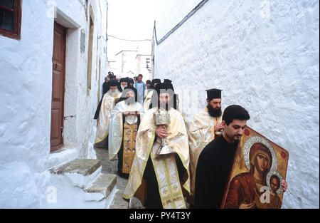 Greek orthodox monks in procession carrying sacred relics during Holy Week celebrations on the Greek island of Patmos. - Stock Photo