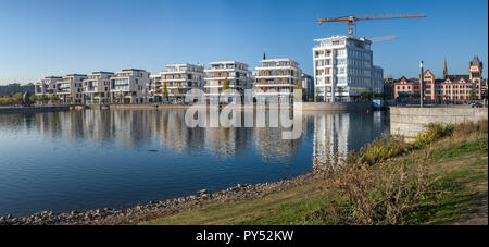 Dortmund, Germany, October 20., 2018: Panorama of the Neubaten at the Phönix Lake with the construction site for the office - Stock Photo