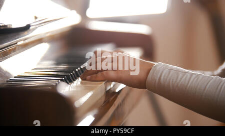 A baby playing piano on music lesson