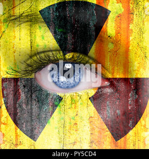 Radioactive background painted on woman face with blue eye - Stock Photo