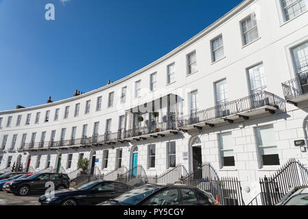 Distinctive curved row of Regency buildings comprising offices and flats in The Royal Crescent in Cheltenham, Gloucestershire - Stock Photo