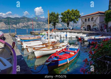 Cassone, Garda Lake, Italy. Cassone is one of the less visited beautiful small fishing villages at Lake Garda - Stock Photo