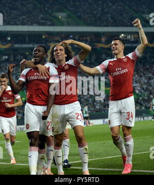 Lisbon, Portugal. 25th Oct, 2018. Players of Arsenal celebrate during the Europa League Group E third round soccer match between Sporting CP and Arsenal FC at Jose Alvalade Stadium in Lisbon, Portugal, on Oct. 25, 2018. Arsenal won 1-0. Credit: Zhang Liyun/Xinhua/Alamy Live News - Stock Photo