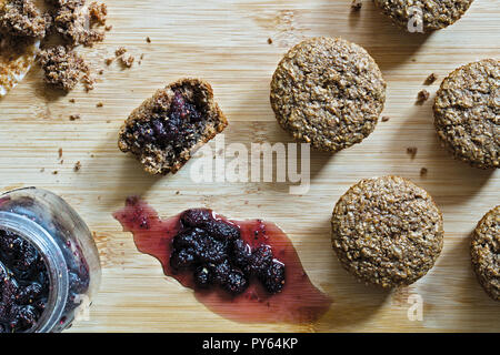 Bran Muffins with home made Mulberry jam on a wooden surface. Top view. - Stock Photo