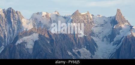 Dramatic clouds swoop in Over Grandes Jorassess and Mer de Glace at sunset. - Stock Photo