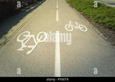 Bike lane asphalt road with marking destined for bicycle transportation. - Stock Photo