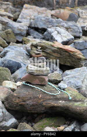 Pebble statue stack, Howdiement Sands, Longhoughton, Northumberland - Stock Photo