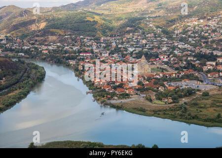 Top view to confluence of Aragvi and Kura rivers, town of Mtskheta and Svetitskhoveli Cathedral - Stock Photo