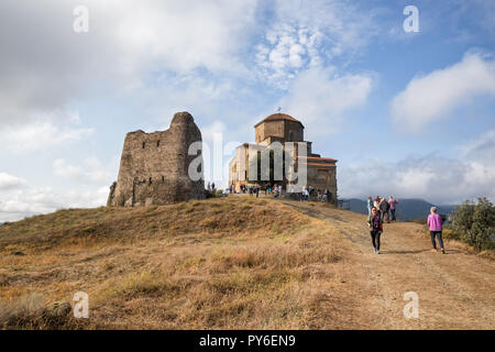 MTSKHETA, GEORGIA - SEPTEMBER 23, 2018: Many people visit ancient Jvari monastery on top of mountain near Mtskheta. - Stock Photo