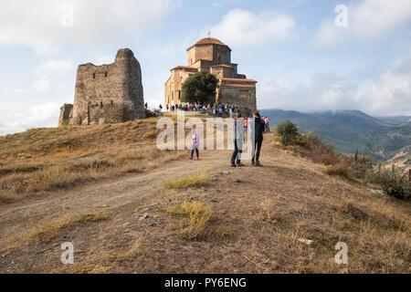 MTSKHETA, GEORGIA - SEPTEMBER 23, 2018: Many people visit ancient Jvari monastery on top of mountain near Mtskheta - Stock Photo