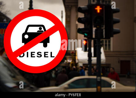Diesel car Prohibition sign and Berlin street and traffic light blurred on the background. Symbolizing that German court banned older diesel cars in p - Stock Photo