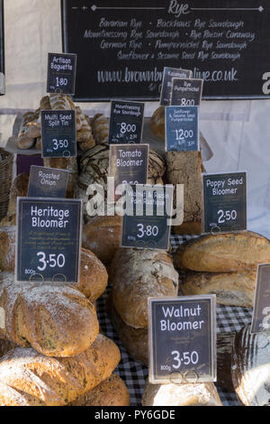Selection of rustic and artisan breads on a market stall, Olney, Buckinghamshire, UK - Stock Photo