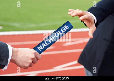 Businessmen passing baton with german word - Nachfolge - Stock Photo