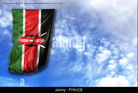Flag of Kenya. Vertical flag, against blue sky with place for your text - Stock Photo