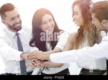 Close-up of business partners making pile of hands - Stock Photo