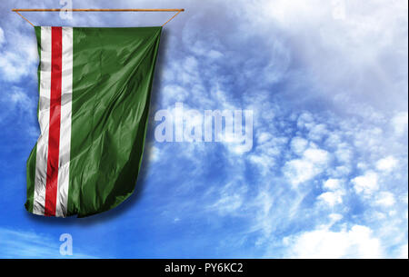 Flag of Chechen Republic of Ichkeria. Vertical flag, against blue sky with place for your text - Stock Photo