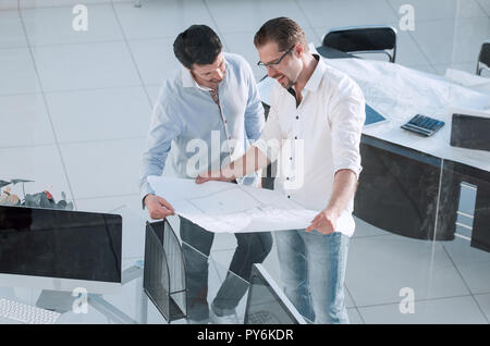 top view.two architects standing in a creative office - Stock Photo