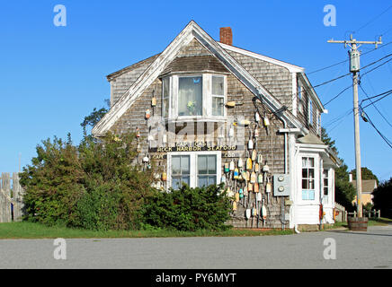 Side view of Cap't Cass Rock Harbor Seafood Restaurant, Orleans, Massachusetts, displaying wooden buoys - Stock Photo