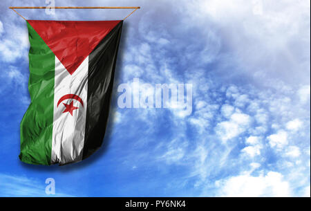 Flag of Western Sahara. Vertical flag, against blue sky with place for your text - Stock Photo