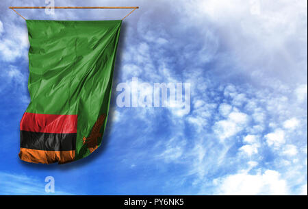 Flag of Zambia. Vertical flag, against blue sky with place for your text - Stock Photo