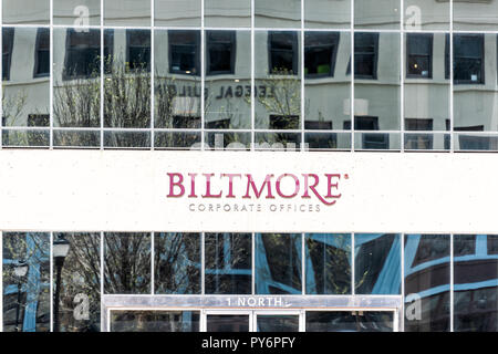 Asheville, USA - April 19, 2018: Downtown old town hipster North Carolina NC famous town, city with closeup sign for Biltmore corporate offices - Stock Photo