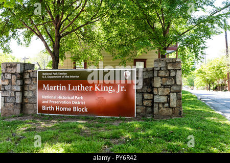 Atlanta, USA - April 20, 2018: Historic MLK Martin Luther King Jr National Park sign of birth home block in Georgia downtown, green trees in urban cit