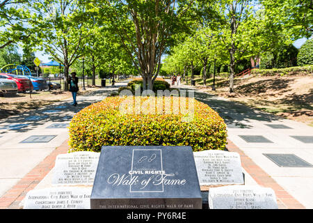 Atlanta, USA - April 20, 2018: Historic MLK Martin Luther King Jr National Park sign of walk of fame in Georgia downtown, green trees in urban city - Stock Photo