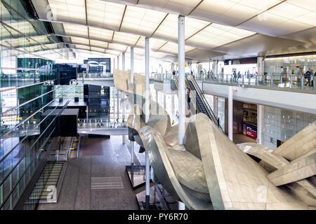 Longford, UK - September 17, 2018: Heathrow Airport modern architecture London airport, people, Slipstream sculpture - Stock Photo