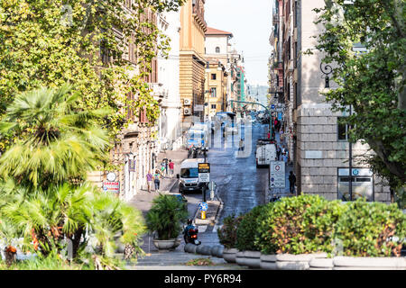 Rome, Italy - September 4, 2018: Streetscape of city town road Via Urbana sign and Piazza Esquilino park square, framing of street by green trees in R - Stock Photo