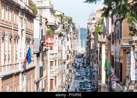 Rome, Italy - September 4, 2018: Historic city with church Santissima Trinita dei Monti column tower, summer day by Spanish Steps between buildings na - Stock Photo