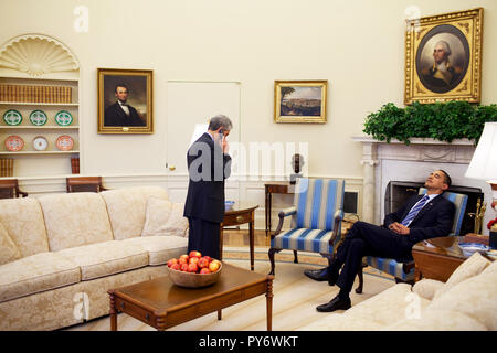 President Barack Obama rests his head on his chair while Chief of Staff Rahm Emanuel talks on cell phone in the Oval Office 2/11/09.  Official White House Photo by Pete Souza - Stock Photo