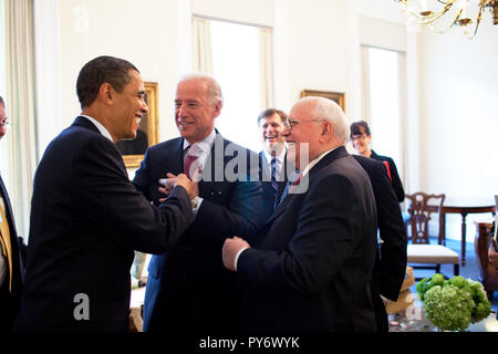 President Barack Obama drops by VP Joe Biden's meeting with former  Soviet Union President Mikhail Gorbachev in the Vice President's Office, West Wing 3/20/09.  Official White House Photo by Pete Souza - Stock Photo
