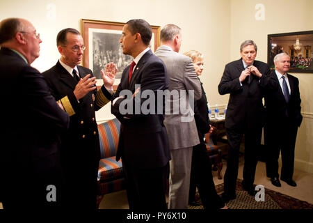 President Barack Obama talks with Admiral Michael Mullen, Chairman of the Joint Chiefs of Staff prior to a policy speech on strategy for Afghanistan and Pakistan. 3/27/09  Official White House Photo by Pete Souza - Stock Photo