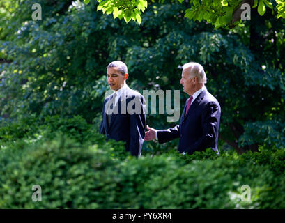 President Barack Obama and Vice President Joe Biden walk to the Rose Garden of the White House to take part in the Top Cops ceremony May 12, 2009.  Official White House Photo by Chuck Kennedy. This official White House photograph is being made available for publication by news organizations and/or for personal use printing by the subject(s) of the photograph. The photograph may not be manipulated in any way or used in materials, advertisements, products, or promotions that in any way suggest approval or endorsement of the President, the First Family, or the White House. - Stock Photo
