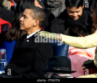 Michelle Obama gives President-elect Barack Obama support before the swearing-in ceremony at the U.S. Capitol in Washington, D.C., Jan. 20, 2009. DoD photo by Master Sgt. Cecilio Ricardo, U.S. Air Force - Stock Photo