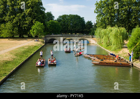People enjoying punt boat rides along a stretch of the river Cam on a sunny Summer afternoon, Cambridge, UK - Stock Photo