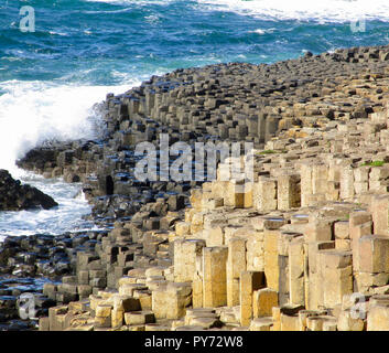 View of the hexagon shaped basalt stone columns in the landscape of Giant's Causeway in Northern Ireland