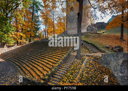 Fortress ruins and ancient steps covered by yellow autumn leaves - Stock Photo